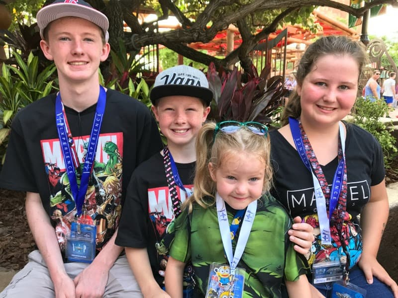 Kids at universal orlando in marvel shirts