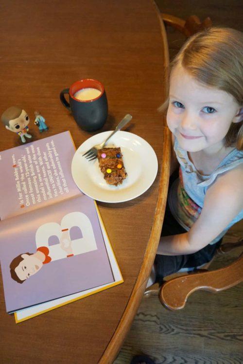 little girl eating Stranger Things alphabet wall brownies