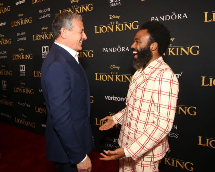 HOLLYWOOD, CALIFORNIA - JULY 09: The Walt Disney Company Chairman and CEO Bob Iger (L) and Donald Glover Lion King World premiere red carpet