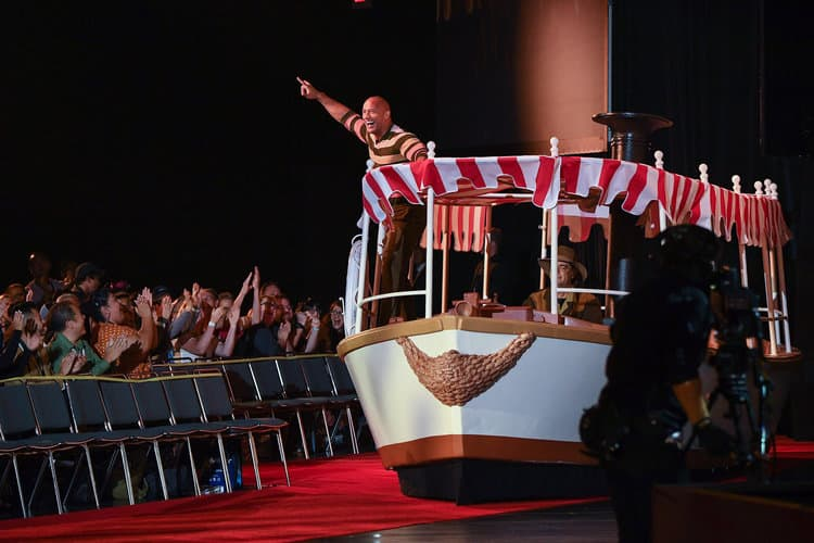 DWAYNE JOHNSON rides in on a jungle cruise boat at D23 Expo