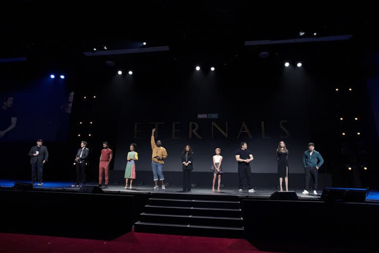 CAst of the Eternals on stage at D23 Expo KEVIN FEIGE (PRESIDENT, MARVEL STUDIOS), RICHARD MADDEN, KUMAIL NANJIANI, LAUREN RIDLOFF, BRIAN TYREE HENRY, SALMA HAYEK, LIA MCHUGH, DON LEE, ANGELINA JOLIE, BARRY KEOGHAN