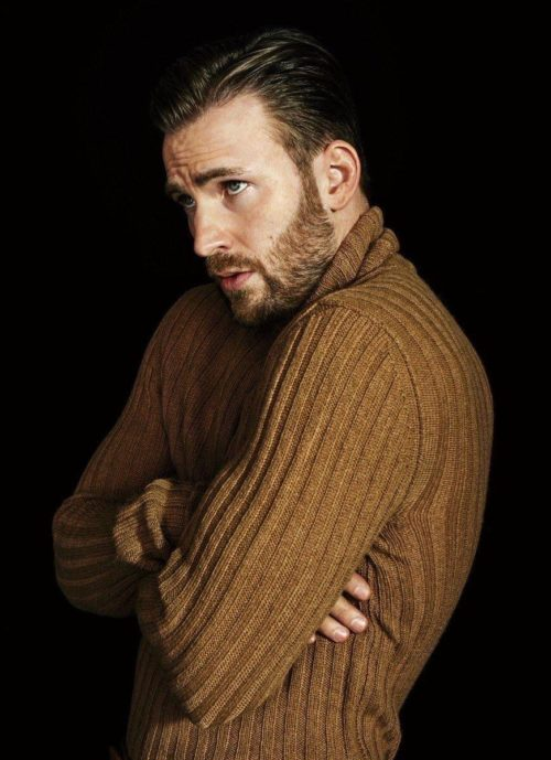 Chris Evans in a sweater camel color