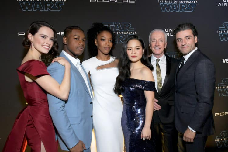 "World Premiere Of ""Star Wars: The Rise of Skywalker"" cast standing on red carpet together"