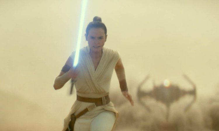 Rey running with lightsaber away from tie fighter in the desert Rise of Skywalker Parent movie review