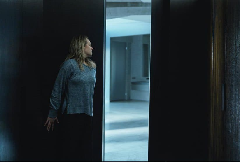 Elisabeth Moss looks around a corner of a dark house Is The Invisible Man Kid-friendly? <a href=