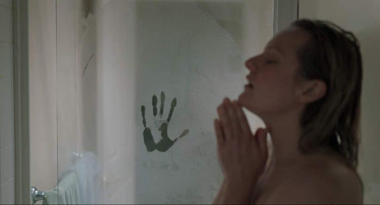 The Invisible Man parent movie review handprint on the shower door while woman is in the shower